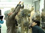 Jane Portal and Caroline Ingham measuring up a Terracotta Warrior